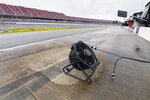 A fan dries an area on pit row before a NASCAR Cup series auto race Sunday, Oct. 3, 2021, in Talladega, Ala. (AP Photo/John Amis)