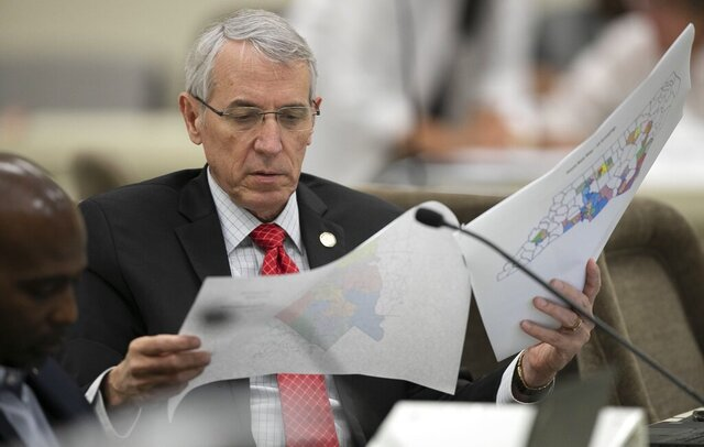 FILE - In this Sept. 12, 2019, file photo, State Rep. John Szoka of Fayetteville, looks over a redistricting map during a committee meeting at the Legislative Office Building in Raleigh, N.C. The reins of political power will be at stake in the 2020 U.S. elections — not just for the presidency, but for thousands of low-profile elections for state House and Senate seats. (Robert Willett/The News & Observer via AP, File )