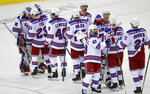 New York Rangers celebrate with goaltender Alexandar Georgiev (40, left) after their 6-3 win over the New Jersey Devils in an NHL hockey game in Newark N.J., on Saturday, March 6, 2021. (Andrew Mills/NJ Advance Media via AP)