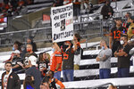 Cleveland Browns fans watch during the first half of an NFL football game between the Cleveland Browns and the Cincinnati Bengals, Thursday, Sept. 17, 2020, in Cleveland. (AP Photo/David Richard)