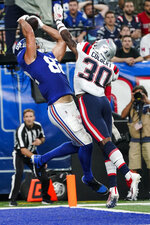 New York Giants tight end Kaden Smith (82) catches a pass in front of New England Patriots free safety Adrian Colbert (30) for a touchdown during the first half of an NFL preseason football game Sunday, Aug. 29, 2021, in East Rutherford, N.J. (AP Photo/John Minchillo)