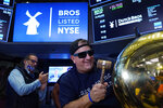 CORRECTS TITLE TO EXECUTIVE CHAIRMAN, NOT PRESIDENT - Dutch Bros Coffee Co-founder and Executive Chairman Travis Boersma rings the ceremonial first trade bell on the floor of the New York Stock Exchange, as his company's IPO opens, Wednesday, Sept. 15, 2021. (AP Photo/Richard Drew)