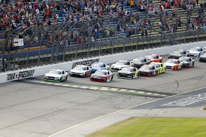 Cole Custer (00) leads at the start of a NASCAR Xfinity Series auto race, Sunday, June 16, 2019, at Iowa Speedway in Newton, Iowa. (AP Photo/Charlie Neibergall)