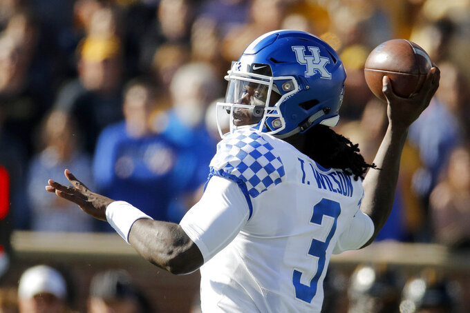 Kentucky quarterback Terry Wilson passes during the first half of an NCAA college football game against Missouri Saturday, Oct. 27, 2018, in Columbia, Mo. (AP Photo/Charlie Riedel)