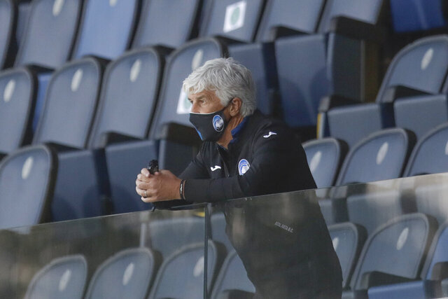 Atalanta's head coach Gian Piero Gasperini follows the game from the stands after getting a red card during the Serie A soccer match between Atalanta and Sassuolo at the Gewiss Stadium in Bergamo, Italy, Sunday, June 21, 2020. Atalanta is playing its first match in Bergamo since easing of lockdown measures, in the area that has been the epicenter of the hardest-hit province of Italy's hardest-hit region, Lombardy, the site of hundreds of COVID-19 deaths. (AP Photo/Luca Bruno)