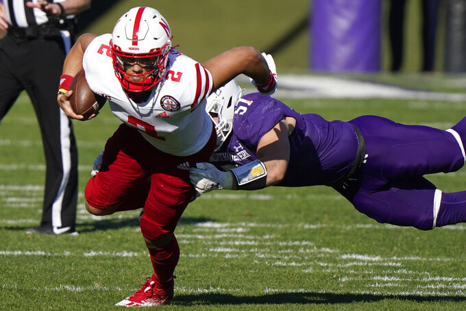 Nebraska quarterback Adrian Martinez, left, is tackled by Northwestern linebacker Blake Gallagher during the second half of an NCAA college football game in Evanston, Ill., Saturday, Nov. 7, 2020. Northwestern won 21-13. (AP Photo/Nam Y. Huh)