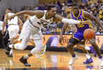 Missouri's Kevin Puryear, left, grabs a loose ball in front of LSU's Darius Days, right, during the first half of an NCAA college basketball game Saturday, Jan. 26, 2019, in Columbia, Mo. (AP Photo/L.G. Patterson)
