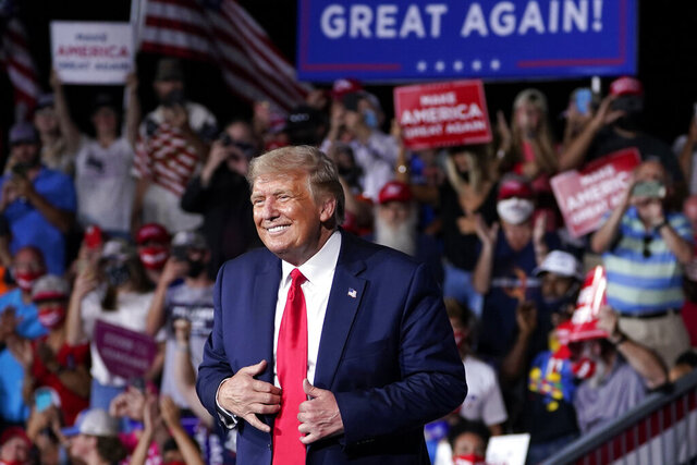 President Donald Trump stands on stage after speaking at a campaign rally at Smith Reynolds Airport, Tuesday, Sept. 8, 2020, in Winston-Salem, N.C. (AP Photo/Evan Vucci)