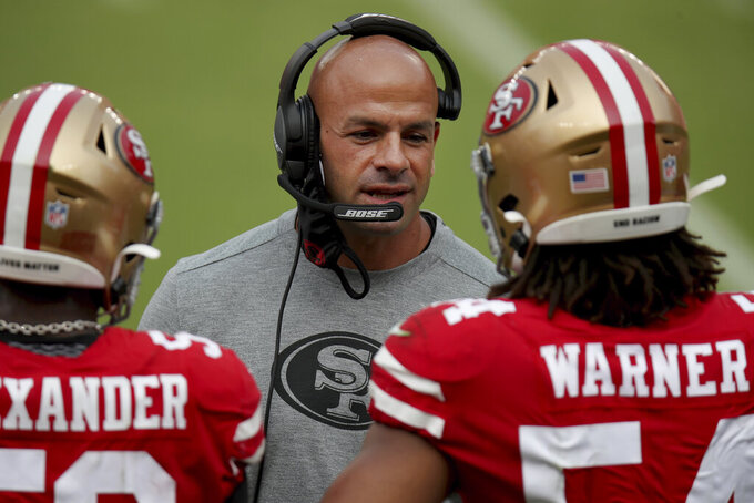 FILE - In this Sept. 13, 2020, file photo, San Francisco 49ers defensive coordinator Robert Saleh talks to players on the sideline during the team's NFL football game against the Arizona Cardinals in Santa Clara, Calif. Saleh inherited one of the worst defenses in the league when he arrived in 2017 and helped turn it into a dominant unit that helped the Niners reach the Super Bowl last season and remain in contention this season despite the string of injuries on both sides of the ball. (AP Photo/Scot Tucker, File)