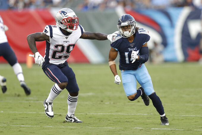 New England Patriots defensive back Duke Dawson (29) defends against Tennessee Titans wide receiver Kalif Raymond (14) in the first half of a preseason NFL football game Saturday, Aug. 17, 2019, in Nashville, Tenn. (AP Photo/James Kenney)