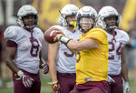 FILE - In this Aug. 7, 2018, file photo, Minnesota quarterback Zack Annexstad throws a pass during NCAA college football practice in Minneapolis. Annexstad won the starting quarterback job at Minnesota as a true freshman. Now comes the hard part, trying to boost a lagging passing game for the Gophers. Annexstad's debut comes on Thursday night in the season opener against New Mexico State. (Elizabeth Flores/Star Tribune via AP, File)