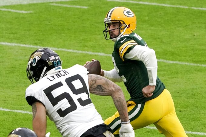 Green Bay Packers' Aaron Rodgers runs for a touchdown during the first half of an NFL football game Sunday, Nov. 15, 2020, in Green Bay, Wis. (AP Photo/Morry Gash)
