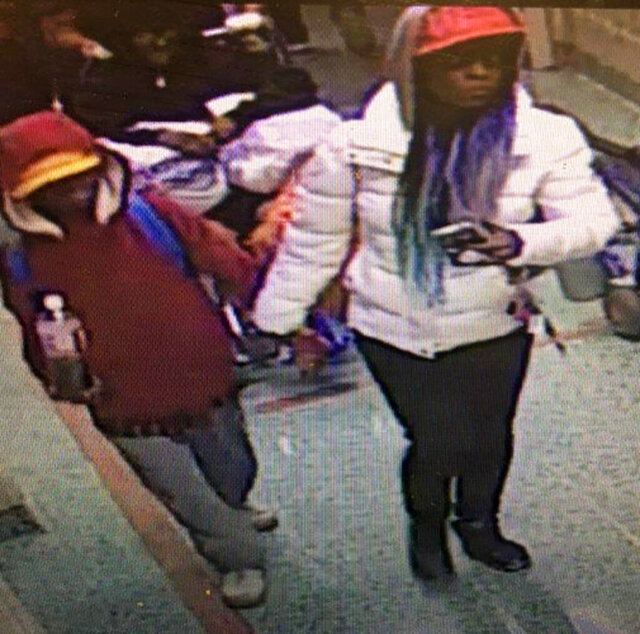 In this image taken from surveillance video released by the Atlanta Police Department, a woman escorts a young man into Grady Memorial Hospital in Atlanta on the night of Wednesday, Dec. 4, 2019. The young man, who appeared to be malnourished and is unable to communicate, was later found alone with no identification. Atlanta police are asking for the public's help in identifying the pair.  (Atlanta Police Department via AP)