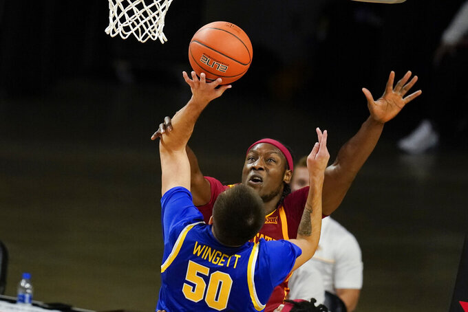 South Dakota State guard David Wingett (50) is fouled by Iowa State forward Solomon Young during the first half of an NCAA college basketball game, Wednesday, Dec. 2, 2020, in Ames, Iowa. (AP Photo/Charlie Neibergall)