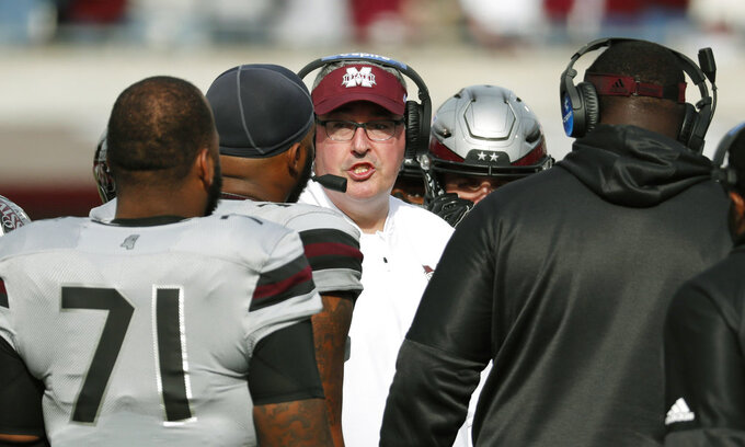 Mississippi State head coach Joe Moorhead speaks to his players during a time out in the second half of an NCAA college football game against Arkansas in Starkville, Miss., Saturday, Nov. 17, 2018. Mississippi State won 52-6. (AP Photo/Rogelio V. Solis)