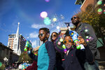 In this Monday, Jan. 15, 2018 photo,  Jaylen Chukudebelu, left, and his brother, Cameron, blow bubbles as they watch The