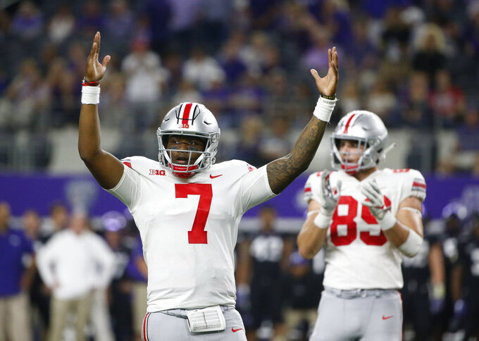FILE - In this Saturday, Sept. 15, 2018, file photo, Ohio State quarterback Dwayne Haskins (7) and tight end Luke Farrell (89) react during the second half of an NCAA college football game against TCU in Arlington, Texas. Traditional Big Ten powers Wisconsin, Michigan and Michigan State have lost out-of-conference games. There are only five unbeaten teams remaining in the conference, and that number seriously might be down to one at the end of the month after No. 4 Ohio State plays at No. 10 Penn State. Slow starts, however, doesn't mean the conference is out of the national title hunt. (AP Photo/Michael Ainsworth, File)