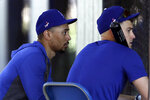 Los Angeles Dodgers outfielder Mookie Betts, left, waits with right fielder Joc Pederson, right, at the batting cages during spring baseball training Monday, Feb. 17, 2020, in Phoenix. (AP Photo/Gregory Bull)