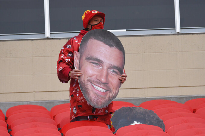 A fan holds a cutout of Kansas City Chiefs tight end Travis Kelce before the AFC championship NFL football game between the Chiefs and the Buffalo Bills, Sunday, Jan. 24, 2021, in Kansas City, Mo. (AP Photo/Reed Hoffmann)