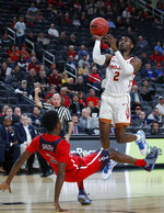 Southern California's Jonah Mathews (2) drives into Arizona's Dylan Smith while shooting in the first half of an NCAA college basketball game in the first round of the Pac-12 conference tournament Wednesday, March 13, 2019, in Las Vegas. (AP Photo/John Locher)