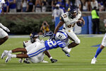 North Carolina A&T running back Bhayshul Tuten (33) tries to evade a tackle by Duke safety Jalen Alexander (32) during the first half of an NCAA college football game in Durham, N.C., Friday, Sept. 10, 2021. (AP Photo/Chris Seward)