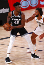 Sacramento Kings' Harry Giles III, left, is defended by New Orleans Pelicans' Jahlil Okafor during the second quarter of an NBA basketball game Tuesday, Aug. 11, 2020, in Lake Buena Vista, Fla. (Mike Ehrmann/Pool Photo via AP)