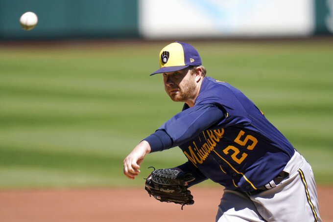 Milwaukee Brewers starting pitcher Brett Anderson throws during the first inning of a baseball game against the St. Louis Cardinals Sunday, April 11, 2021, in St. Louis. (AP Photo/Jeff Roberson)