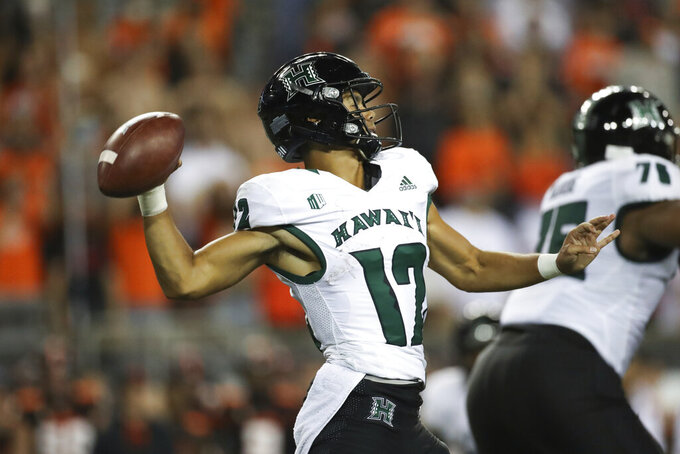 Hawaii quarterback Chevan Cordeiro (12) throws a pass during the second half of an NCAA college football game against Oregon State, Saturday, Sept. 11, 2021, in Corvallis, Ore. Oregon State won 45-27. (AP Photo/Amanda Loman)