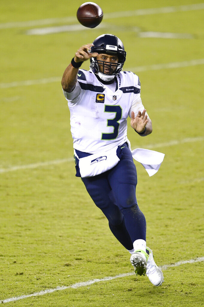 Seattle Seahawks' Russell Wilson passes during the second half of an NFL football game against the Philadelphia Eagles, Monday, Nov. 30, 2020, in Philadelphia. (AP Photo/Derik Hamilton)