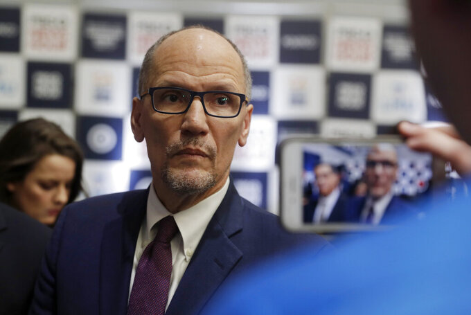 FILE - In this Dec. 19, 2019, file photo Democratic National Committee chairman Tom Perez is recorded on a phone before a Democratic presidential primary debate in Los Angeles, Calif. (AP Photo/Chris Carlson, File)