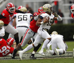 Georgia Tech quarterback TaQuon Marshall (16) is chased down by Georgia defensive end Jonathan Ledbetter (13) during the first half of an NCAA college football game Saturday, Nov. 24, 2018, in Athens, Ga. (AP Photo/John Bazemore)