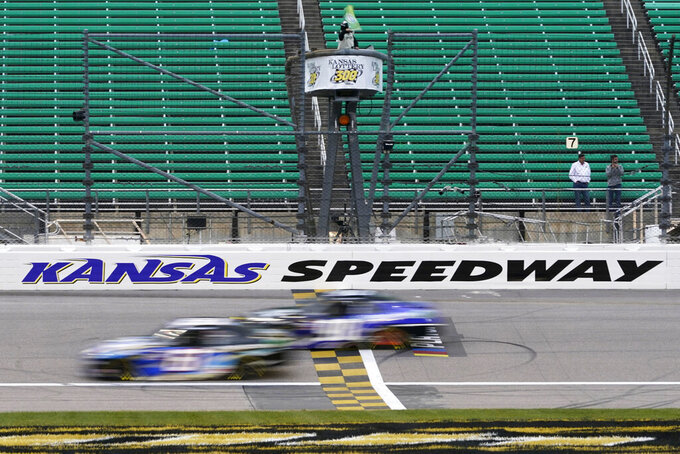 Drivers take the green flag during a NASCAR Xfinity Series auto race at Kansas Speedway in Kansas City, Kan., Saturday, Oct. 17, 2020. (AP Photo/Orlin Wagner)