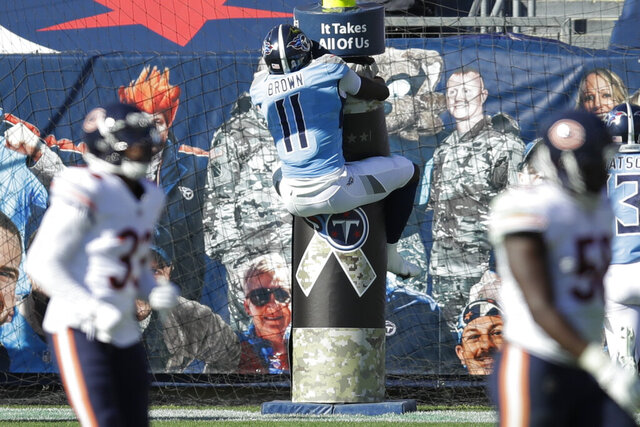 Tennessee Titans wide receiver A.J. Brown (11) jumps onto the goal post after catching a 40-yard touchdown pass against the Chicago Bears in the first half of an NFL football game Sunday, Nov. 8, 2020, in Nashville, Tenn. (AP Photo/Ben Margot)
