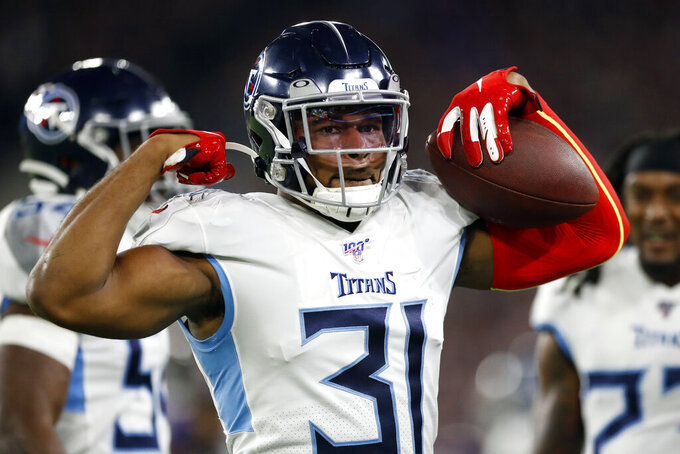 FILE - In this Jan. 11, 2020, file photo, Tennessee Titans free safety Kevin Byard reacts after intercepting a pass during the first half of an NFL divisional playoff football game against the Baltimore Ravens in Baltimore. Byard has the most interceptions in the NFL since the start of the 2017 season, yet his biggest catch came at home. He wound up delivering his son when his wife's contractions prevented them from getting to the hospital. (AP Photo/Julio Cortez, File)