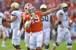 FILE - In this Nov. 16, 2019, file photo, Clemson's Tanner Muse reacts after sacking Wake Forest quarterback Jamie Newman during the first half of an NCAA college football game, in Clemson, S.C. Muse was selected to The Associated Press All-Atlantic Coast Conference football team, Tuesday, Dec. 10, 2019. (AP Photo/Richard Shiro, File)