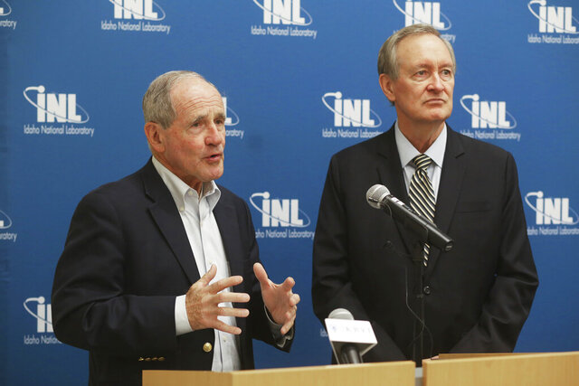 FILE - In this Aug. 14, 2019 file photo, Idaho Republican U.S. Senators James Risch, left, and Mike Crapo speak to audience members during the announcement of the launch of the National Reactor Innovation Center (NRIC) at Idaho National Laboratory in Idaho Falls, Idaho. Idaho's two U.S. senators in speeches to state lawmakers say the country is experiencing historical prosperity and the federal judiciary is being transformed with the appointment of conservative judges. Crapo and Risch in speeches Thursday, Feb. 20, 2020 to state lawmakers in the Idaho House of Representatives labeled the moves as good progress for the country. Crapo says the U.S. Supreme Court now has a five-member majority of what he calls rule-of-law judges. Risch says deregulation has led to economic growth. They did not mention the U.S. budget deficit that is likely to burst through the $1 trillion mark this year. (John Roark/The Idaho Post-Register via AP, File)/The Idaho Post-Register via AP)