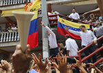 Venezuela's opposition leader and self proclaimed President Juan Guaido, greets supporters in Charallave, on the outskirts of Caracas, Venezuela, Saturday, June 8, 2019. Guaido is involved in a power struggle with President Nicolas Maduro for the government of Venezuela. (AP Photo/Fernando Llano)