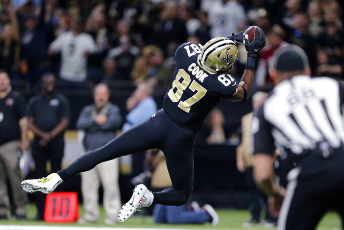 New Orleans Saints tight end Jared Cook (87) pulls in a touchdown reception in the first half an NFL football game against the San Francisco 49ers in New Orleans, Sunday, Dec. 8, 2019. (AP Photo/Brett Duke)
