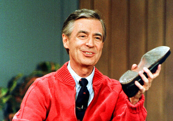 FILE - In this June 28, 1989, file photo, Fred Rogers rehearses for the opening of his PBS show
