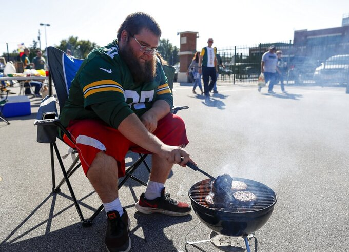 A fan tailgates outside Lambeau Field before a preseason NFL football game between the Green Bay Packers and the Kansas City Chiefs Thursday, Aug. 29, 2019, in Green Bay, Wis. (AP Photo/Matt Ludtke)
