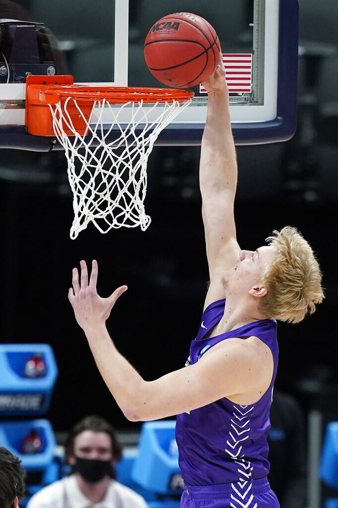 Abilene Christian's Kolton Kohl scores against UCLA during the first half of a college basketball game in the second round of the NCAA tournament at Bankers Life Fieldhouse in Indianapolis Monday, March 22, 2021. (AP Photo/Mark Humphrey)