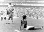 FILE - In this June 21, 1970 file photo, Brazil's Pele jumps for joy after scoring his team's first goal against Italy in the first half of a World Cup final at Azteca Stadium in Mexico City, before winning 4 - 1.  On Oct. 23, 2020, the three-time World Cup winner Pelé turns 80 without a proper celebration amid the COVID-19 pandemic as he quarantines in his mansion in the beachfront city of Guarujá, where he has lived since the start of the pandemic. (AP Photo/Kurt Strumpf, File)