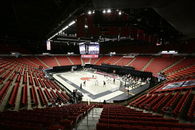 Washington State and Oregon State play during the first half of an NCAA college basketball game at Beasley Coliseum with no fans in attendance due to the COVID-19 pandemic, in Pullman, Wash., Wednesday, Dec. 2, 2020. (AP Photo/Young Kwak)