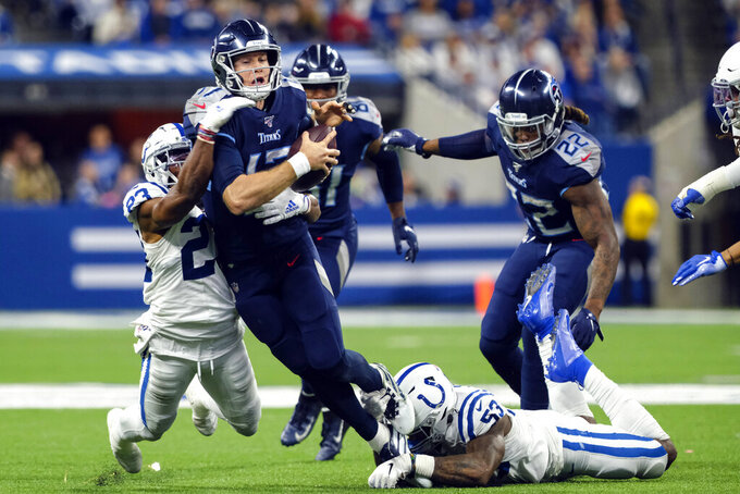 Tennessee Titans quarterback Ryan Tannehill (17) is sacked by Indianapolis Colts outside linebacker Darius Leonard (53) and running back Nyheim Hines (21) during the second half of an NFL football game in Indianapolis, Sunday, Dec. 1, 2019. (AP Photo/AJ Mast)