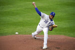 Kansas City Royals starting pitcher Ronald Bolaños throws during the second inning of the team's baseball game against the Chicago White Sox on Saturday, Aug. 1, 2020, in Kansas City, Mo. (AP Photo/Charlie Riedel)