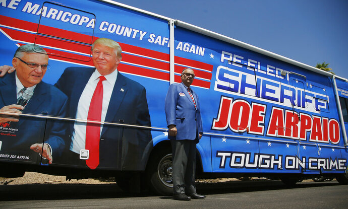 Former Maricopa County Sheriff Joe Arpaio, poses for a photograph in front of his campaign vehicle as he is running for the position of Maricopa County Sheriff again, Wednesday, July 22, 2020, in Fountain Hills, Ariz. Arpaio is trying to win back the sheriff's post in metro Phoenix that he held for 24 years. He faces his former second-in-command, Jerry Sheridan, in the Aug. 4 Republican primary in what has become his second comeback bid. (AP Photo/Ross D. Franklin)