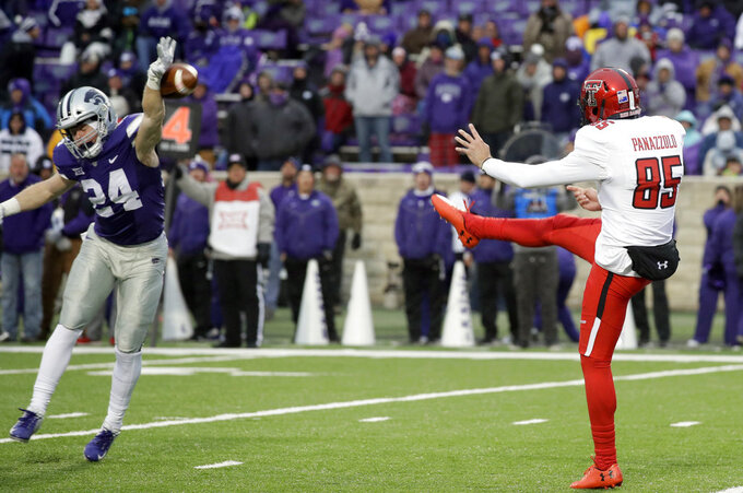 Kansas State defensive back Brock Monty (24) blocks a punt by Texas Tech punter Dominic Panazzolo (85) during the second half of an NCAA college football game in Manhattan, Kan., Saturday, Nov. 17, 2018. (AP Photo/Orlin Wagner)