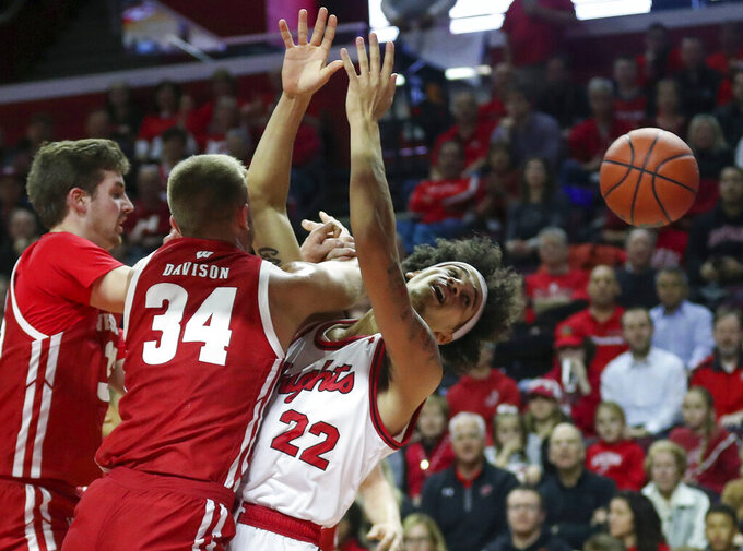 Wisconsin guard Brad Davison (34) collides with Rutgers guard Caleb McConnell (22) as they battle under the basket during the first half of an NCAA college basketball game in Piscataway, N.J., Wednesday, Dec. 11, 2019. (Andrew Mills/NJ Advance Media via AP)