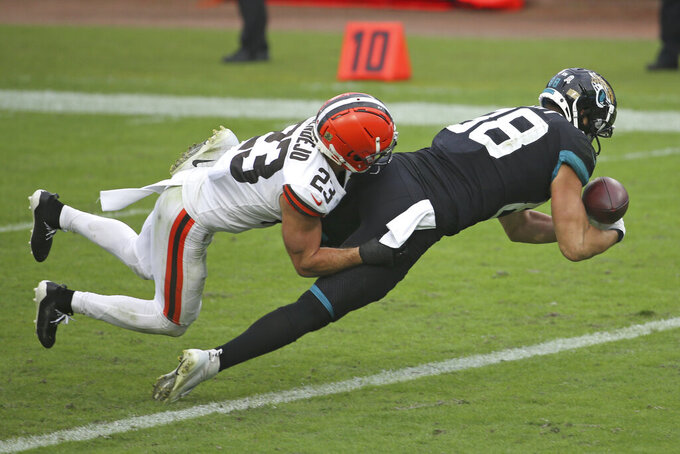 Cleveland Browns safety Andrew Sendejo (23) breaks up a pass intended for Jacksonville Jaguars tight end Tyler Eifert, right, during the second half of an NFL football game, Sunday, Nov. 29, 2020, in Jacksonville, Fla. (AP Photo/Stephen B. Morton)