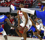 North Carolina State's Torin Dorn (2) tries to keep the ball from Hofstra's Justin Wright-Foreman (3), left, during the first half of an NCAA college basketball game in Raleigh, N.C., Tuesday, March 19, 2019. (Ethan Hyman/The News & Observer via AP)